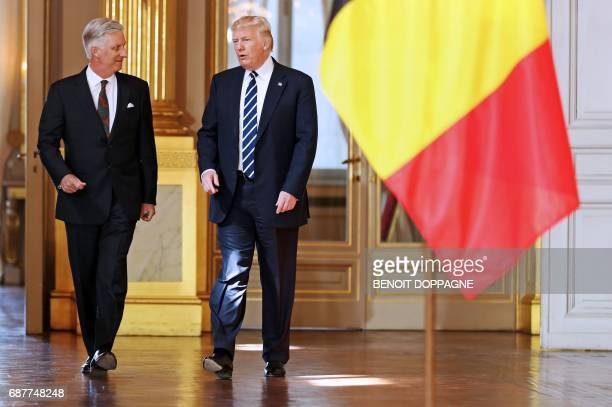 US President Donald Trump speaks with King Philippe Filip of Belgium during a reception at the Royal Palace in Brussels on May 24 2017 Trump is on a...