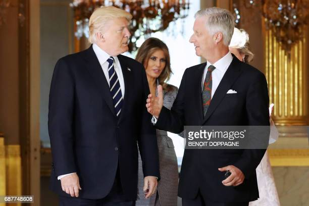 US President Donald Trump speaks with King Philippe Filip of Belgium next to US First Lady Melania Trump during a reception at the Royal Palace in...