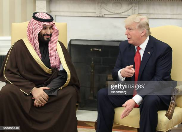 US President Donald Trump speaks with Mohammed bin Salman the Kingdom of Saudi Arabia's deputy crown prince and minister of defense left in the Oval...