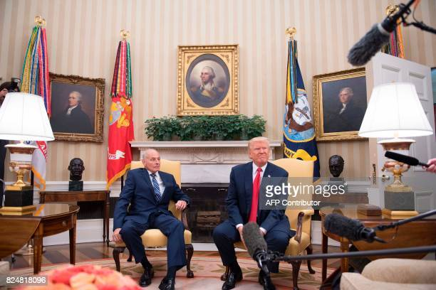 US President Donald Trump speaks with newly swornin White House Chief of Staff John Kelly at the White House in Washington DC on July 31 2017 US...
