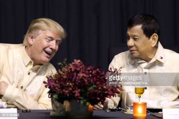 US President Donald Trump speaks with Philippines President Rodrigo Duterte during a special gala celebration dinner for the Association of Southeast...