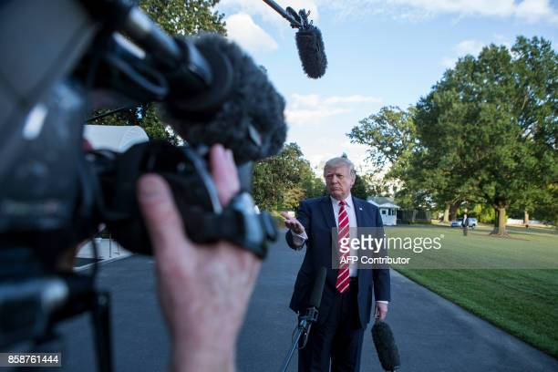US President Donald Trump speaks with reporters outside the White House prior to his departure aboard Marine One on October 7 2017 During the...