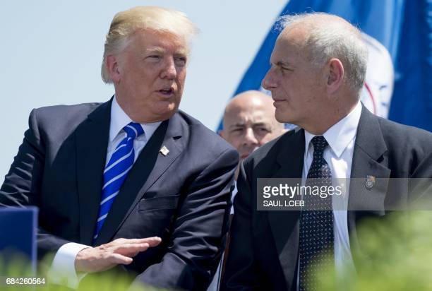 US President Donald Trump speaks witih Secretary of Homeland Security John Kelly during the US Coast Guard Academy Commencemnet Ceremony in New...