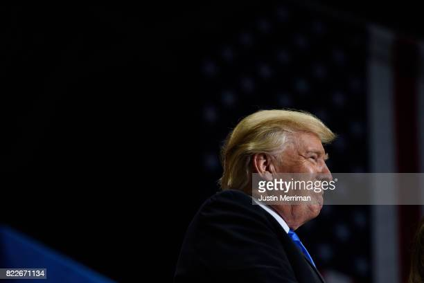 S President Donald Trump stands by as first lady Melania Trump addresses a rally at the Covelli Centre on July 25 2017 in Youngstown Ohio The rally...