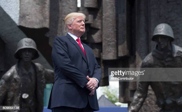 US President Donald Trump stands in front of the Warsaw Uprising Monument on Krasinski Square during the Three Seas Initiative Summit in Warsaw...