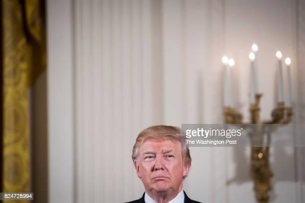 President Donald Trump stands looking out during a ceremony honoring the first responders of the June 14 shooting against members of the Republican...