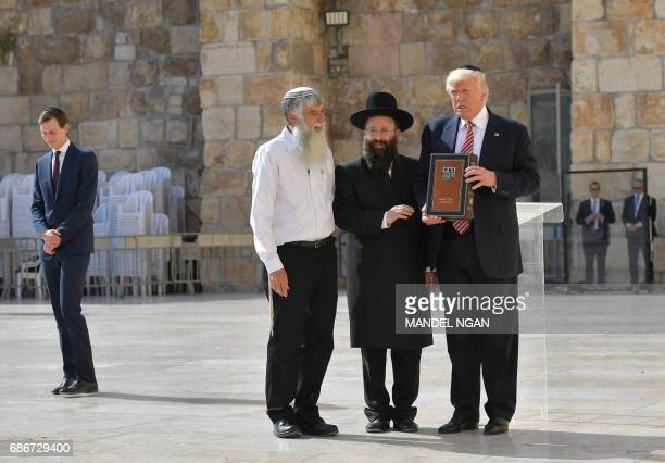 US President Donald Trump stands near Rabbi Shmuel Rabinovitch during a visit to the Western Wall the holiest site where Jews can pray in Jerusalems...