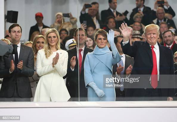 S President Donald Trump stands with his wife first lady Melania Trump daughter Ivanka Trump and her husband Jared Kushner inside of the inaugural...