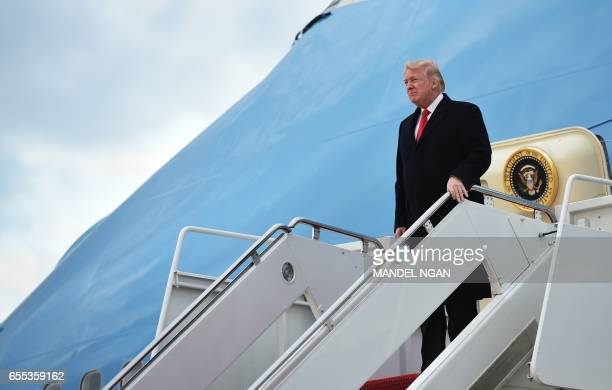US President Donald Trump steps off Air Force One upon arrival at Andrews Air Force Base in Maryland on March 19 after spending the weekend at his...