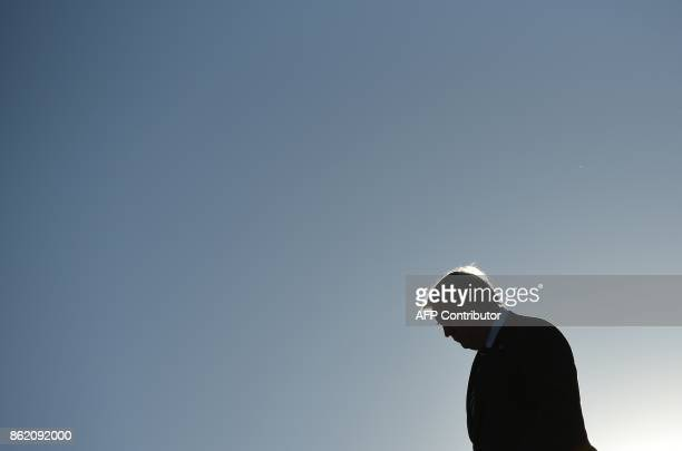 US President Donald Trump steps off Air Force One upon arrival at GreenvilleSpartanburg International Airport in Greer South Carolina on October 16...
