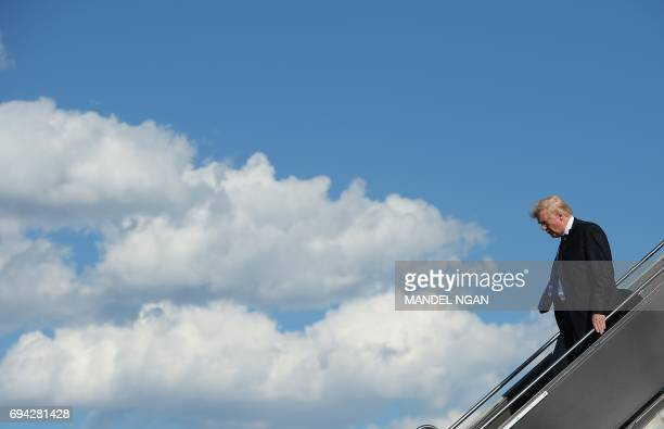 US President Donald Trump steps off Air Force One upon arrival at Newark Liberty Airport in Newark New Jersey on June 9 2017 Trump is heading to his...