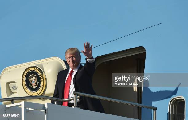 President Donald Trump steps off Air Force One upon arrival at Palm Beach International Airport in West Palm Beach Florida on February 3 2017 / AFP...