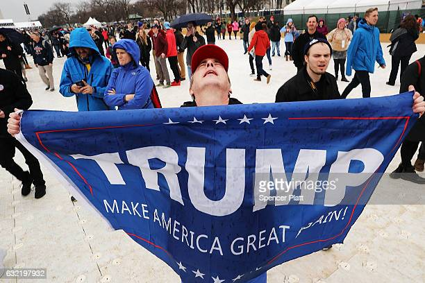 President Donald Trump supporter reacts on the National Mall to the inauguration of US President Donald Trump on January 20 2017 in Washington DC...