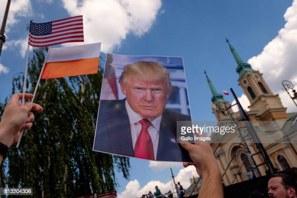 US President Donald Trump supporters gather to hear the American President speak for the first time in Europe since he was elected on July 06 2017 in...