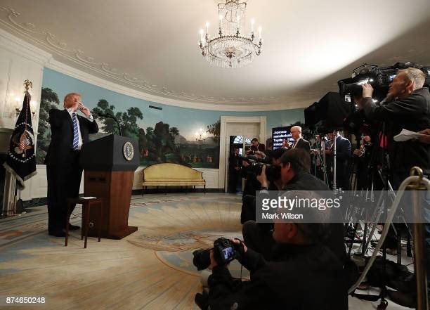President Donald Trump takes a drink of water while speaking about his 12day trip to Asia fair trade and the economy at the White House on November...