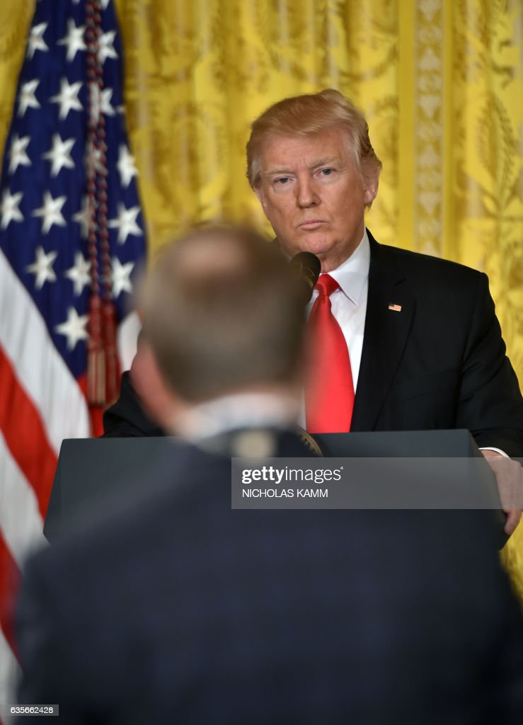 US President Donald Trump takes a question as he speaks during a press conference on February 16, 2017, at the White House in Washington, DC. Trump announced Alexander Acosta as his new nominee to head the US Department of Labor, after his first choice, Andrew Puzder, withdrew from consideration on February 15. / AFP / Nicholas Kamm