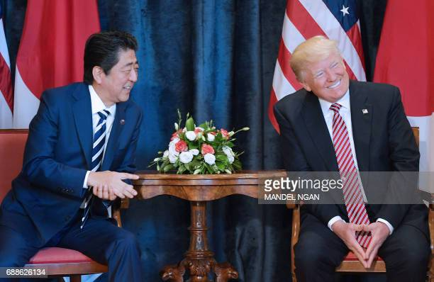 President Donald Trump takes part in a bilateral meeting with Japan's Prime Minister Shinzo Abe at the Villa Diodoro on the sidelines of the Summit...