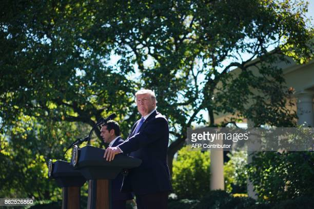 US President Donald Trump takes part in a joing press conference with Greece's Prime Minister Alexis Tsipras in the Rose Garden of the White House on...