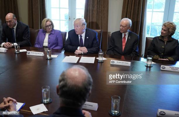 US President Donald Trump takes part in a meeting with members of the the Senate Finance Committee and his ecnonomic team National Economic Council...