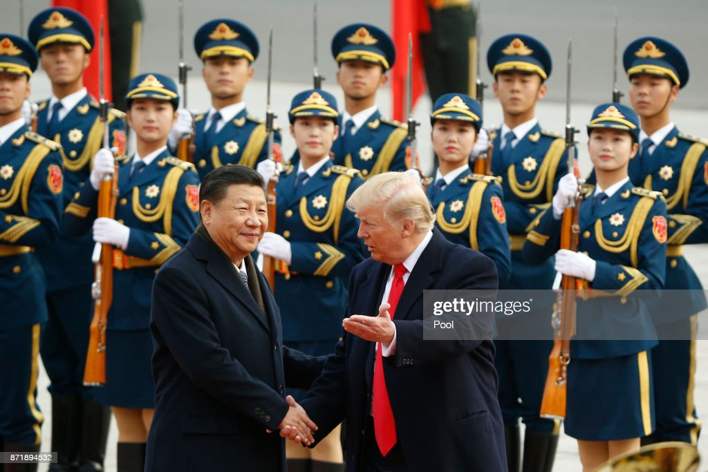 U.S. President Donald Trump takes part in a welcoming ceremony with China's President Xi Jinping on November 9, 2017 in Beijing, China. Trump is on a 10-day trip to Asia.