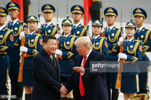 S President Donald Trump takes part in a welcoming ceremony with China's President Xi Jinping on November 9 2017 in Beijing China Trump is on a 10day...