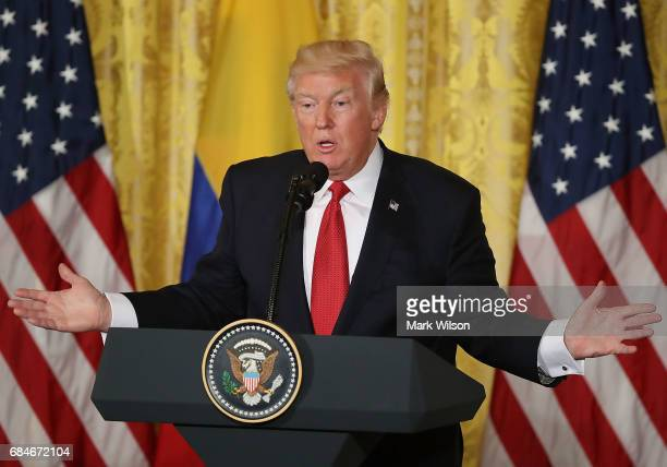 President Donald Trump takes questions from reporters during a joint news conference with Colombian President Juan Manuel Santos at the White House...