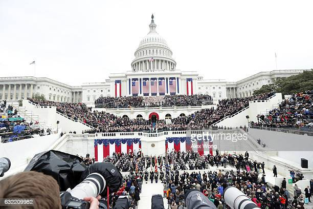 President Donald Trump takes the oath of office from Supreme Court Chief Justice John Roberts on the West Front of the US Capitol on January 20 2017...