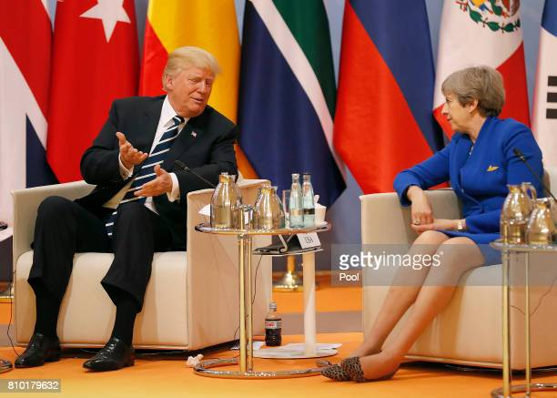 President Donald Trump talks to British Prime Minister Theresa May at the G20 leaders retreat as part of the G20 summit on July 7 2017 in Hamburg...