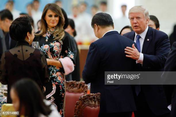 S President Donald Trump talks to China's President Xi Jinping during a state dinner at the Great hall of the People on November 9 2017 in Beijing...