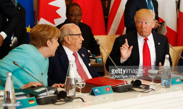 US President Donald Trump talks to German Chancellor Angela Merkel and Tunisia's President Beji Caid Essebsi at the G7 Summit expanded session on May...