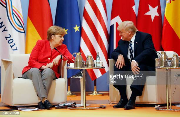 President Donald Trump talks to German Chancellor Angela Merkel during the G20 leaders retreat as part of the G20 summit on July 7 2017 in Hamburg...