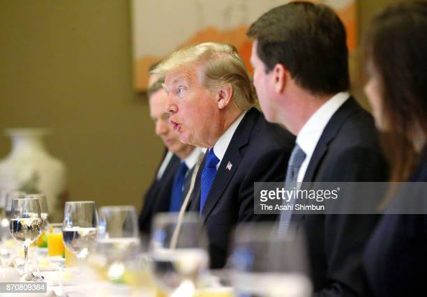 US President Donald Trump talks to Japanese Prime Minister Shinzo Abe during a working lunch at the Akasaka State Guest House on November 6 2017 in...