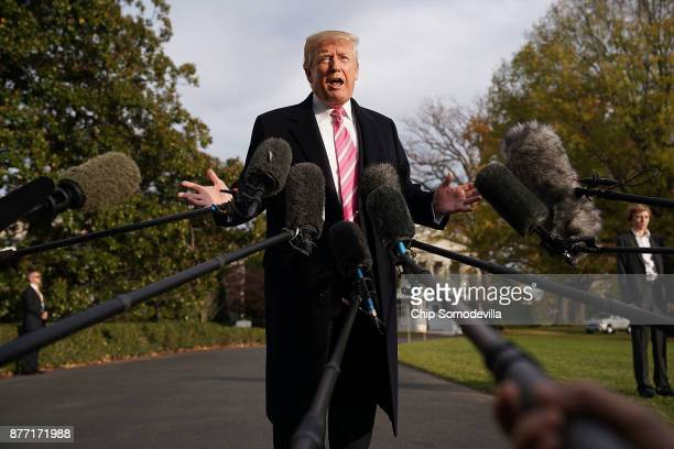 S President Donald Trump talks to reporters as he departs the White House November 21 2017 in Washington DC Trump and his family are going to his...