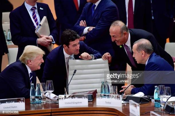 S President Donald Trump talks to the President of Turkey Recep Tayyip Erdogan before the beginning of first working session of the G20 Nations...