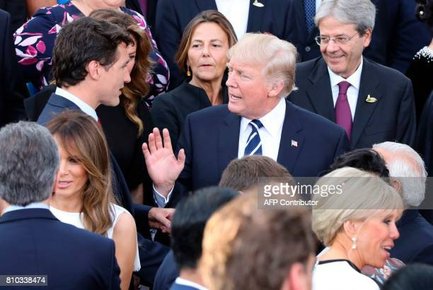 US President Donald Trump talks with Canada's Prime Minister Justin Trudeau and his wife of Canada's Prime Minister Sophie Gregoire as US First Lady...