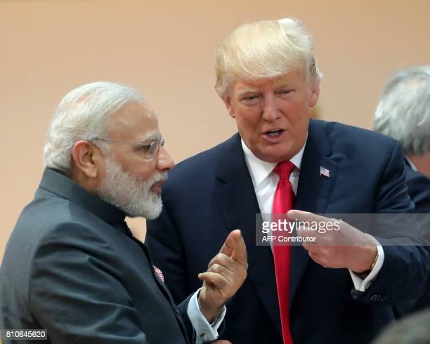 US President Donald Trump talks with India's Prime Minister Narendra Modi as they attend a working session during the G20 summit in Hamburg northern...