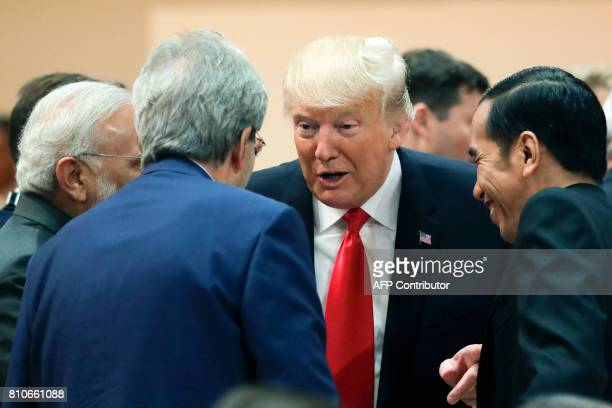 US President Donald Trump talks with India's Prime Minister Narendra Modi Italy's Prime Minister Paolo Gentiloni and Indonesia's President Joko...