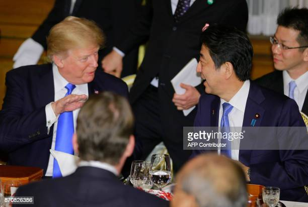 US President Donald Trump talks with Japanese Prime Minister Shinzo Abe at the opening of a welcome dinner hosted by Abe at Akasaka Palace in Tokyo...
