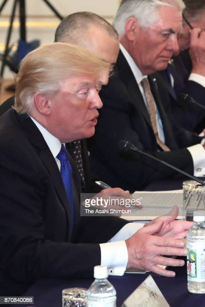 US President Donald Trump talks with Japanese Prime Minister Shinzo Abe during their meeting at the Akasaka State Guest House on November 6 2017 in...