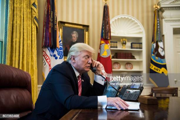President Donald Trump talks with new Irish Prime Minister Leo Varadkar during a telephone call in the Oval Office of the White House of the White...