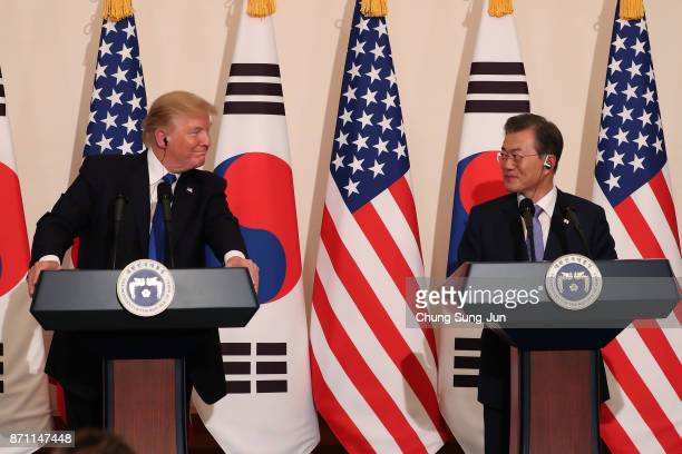S President Donald Trump talks with South Korean President Moon JaeIn during the joint press conference at the presidential Blue House on November 7...