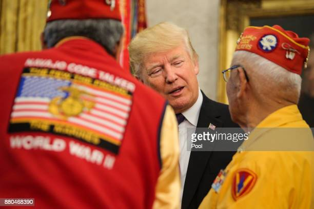 US President Donald Trump talks with Thomas Begay and other members of the Native American code talkers during an event in the Oval Office of the...