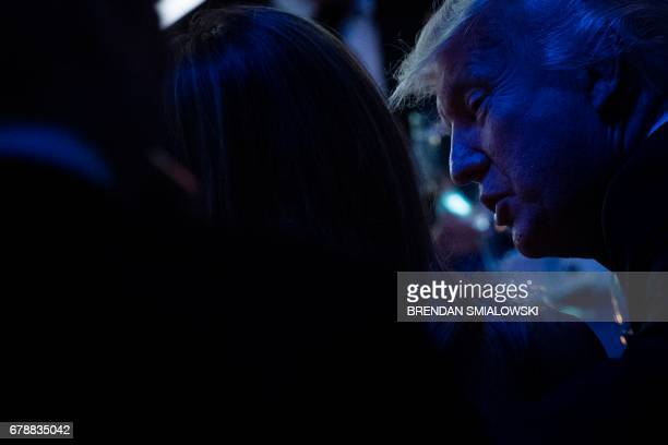 US President Donald Trump talks with US first lady Melania Trump during a dinner to commemorate the 75th anniversary of the Battle of the Coral Sea...
