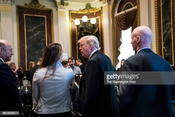 President Donald Trump talks with White House Communications Director Hope Hicks between radio interviews in the Indian Treaty Room of the Eisenhower...