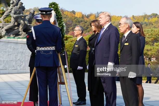 US President Donald Trump third right and US First Lady Melania Trump fourth right participate in a wreathlaying ceremony at the National Cemetery in...
