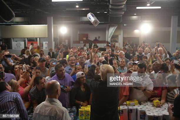 President Donald Trump throws a paper towel roll as he visits the Cavalry Chapel in Guaynabo Puerto Rico on October 3 2017 Nearly two weeks after...