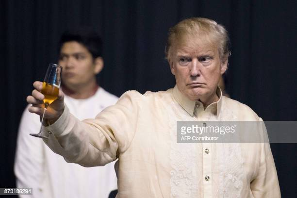 US President Donald Trump toasts during a special gala celebration dinner for the Association of Southeast Asian Nations in Manila on November 12...