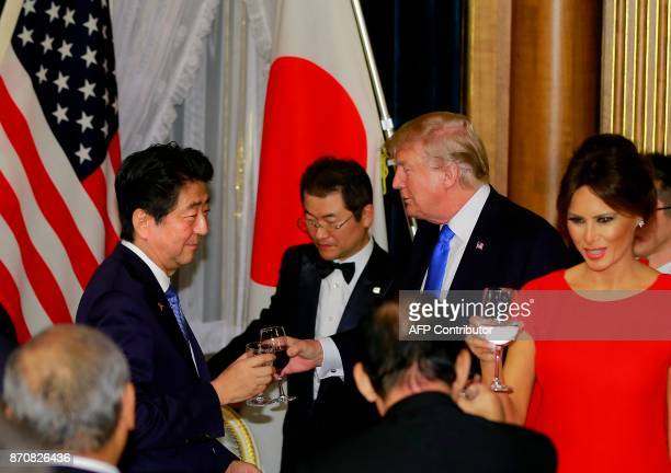 US President Donald Trump toasts with Japanese Prime Minister Shinzo Abe left at the opening of a welcome dinner hosted by Abe at Akasaka Palace in...