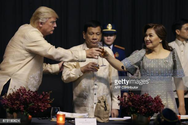 US President Donald Trump toasts with Philippines President Rodrigo Duterte and Honeylet Avancena during a special gala celebration dinner for the...