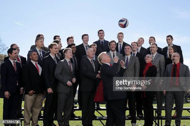 US President Donald Trump tosses a volleyball into the air while congratulating members of the National Collegiate Athletic Association's champion...